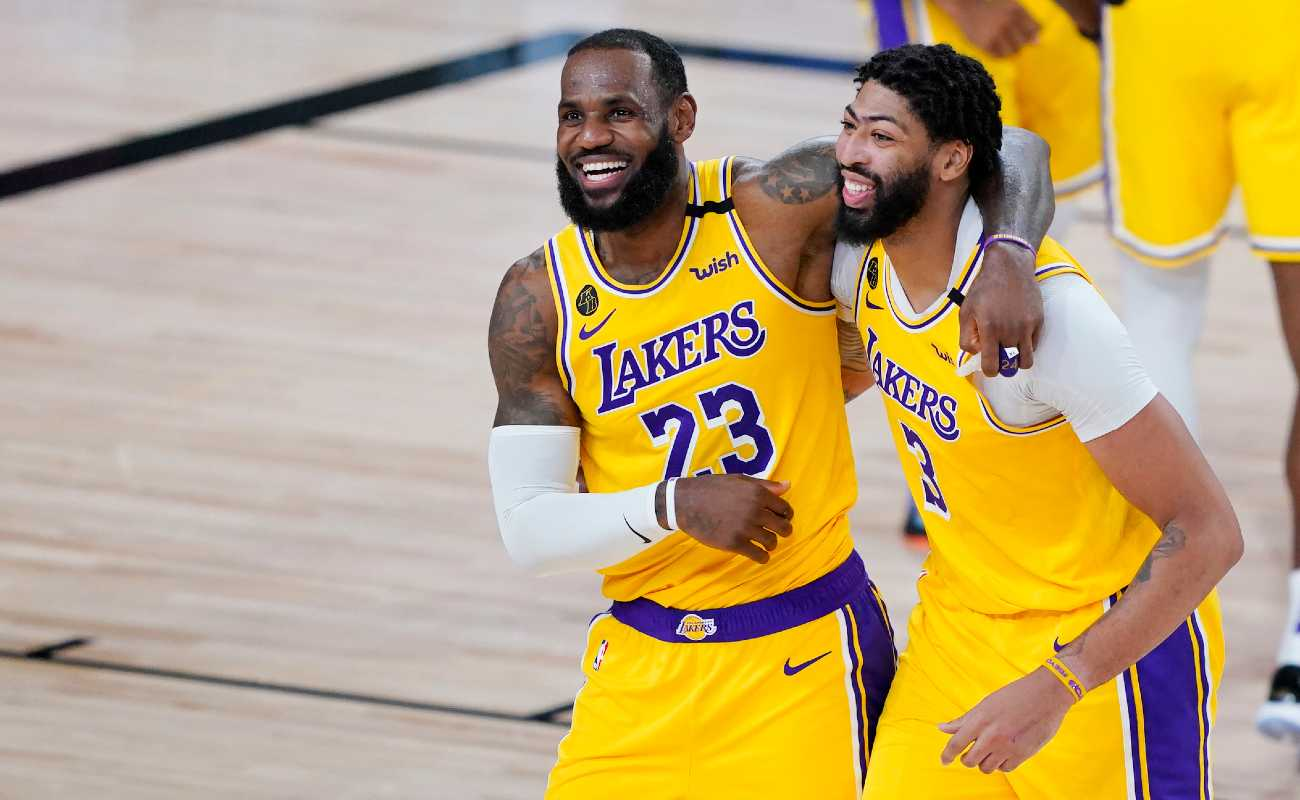 LeBron James and Anthony Davis of the Los Angeles Lakers celebrate after defeating the Denver Nuggets.