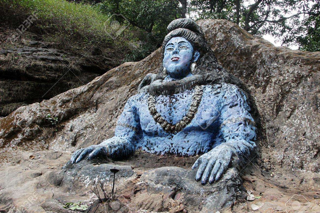 C:\Users\user\Desktop\Reacho\pics\42011244-Rock-cut-and-blue-painted-carving-of-Shiva-also-known-as-Jata-Shankar-near-Jata-Shankar-Cave-Pachmar-Stock-Photo.jpg