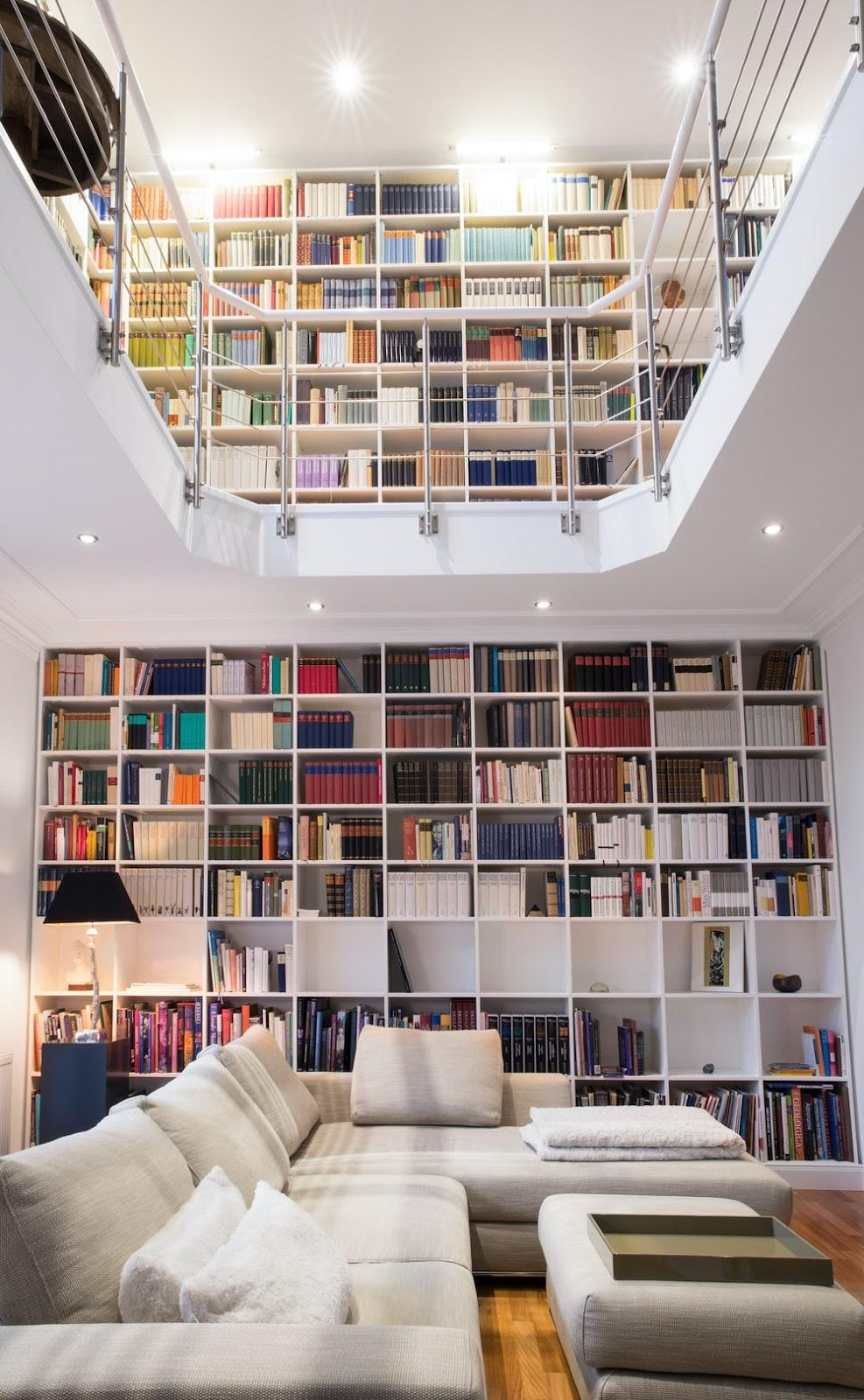 white wooden book shelves with books