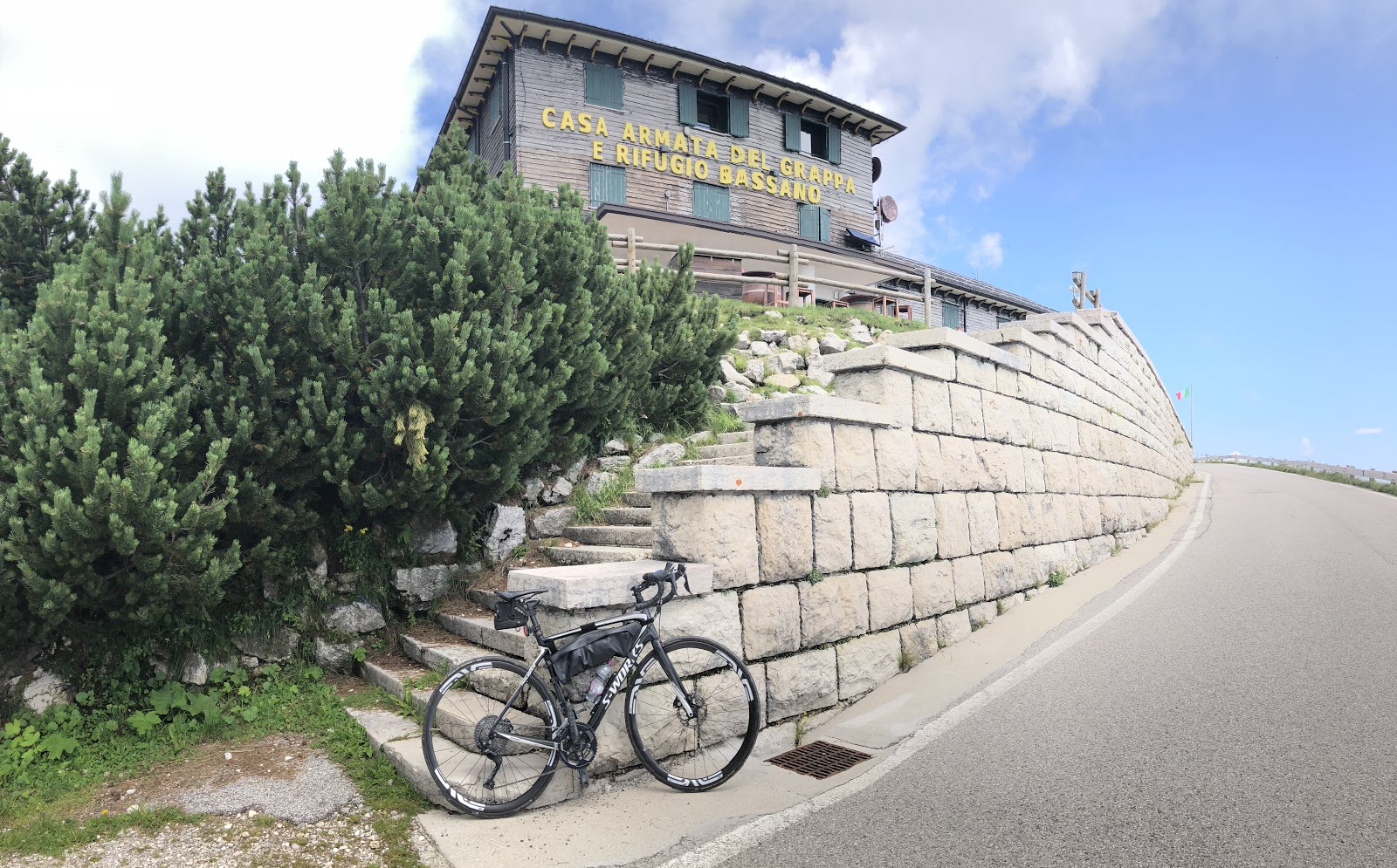 Cycling Monte Grappa from Possagno  - bike leaning against stairs to Rifugio Bassano del Grappa