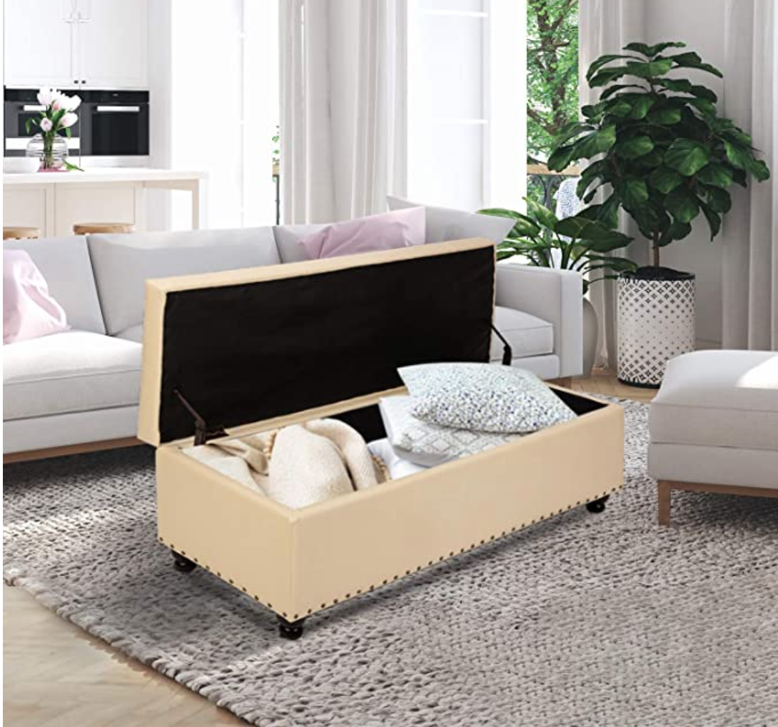 Open beige chest with pillows inside in living room
