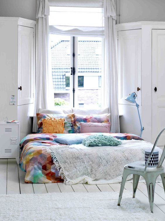 Colorful Bedspread in White Bedroom with Pops of Color