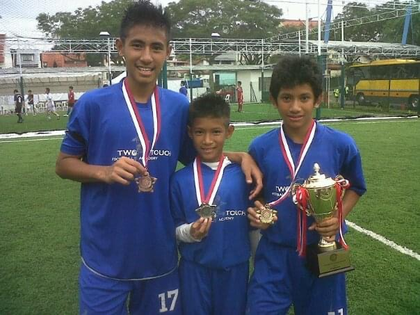 Hanif Sjahbandi and his two brothers posing at his parents Two Touch Academy
