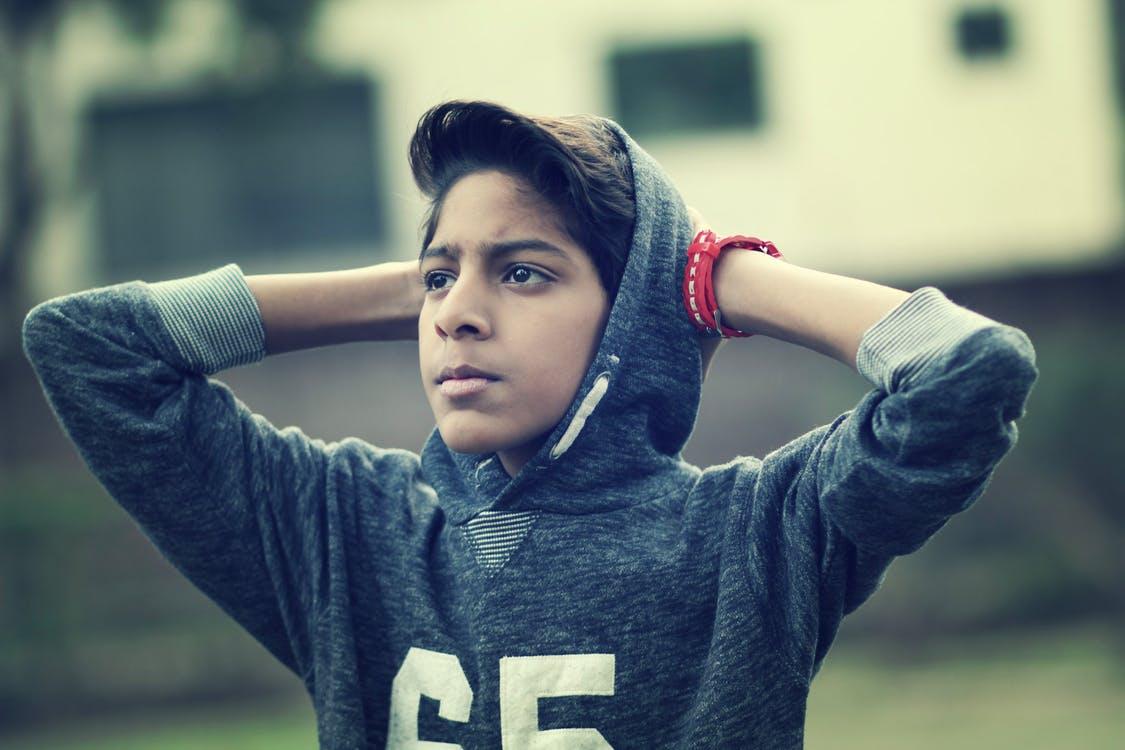 Boy Wearing Pullover Hoodie