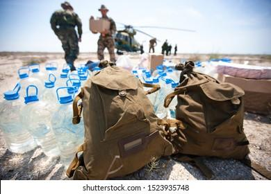 Delivery of humanitarian aid by military helicopter
