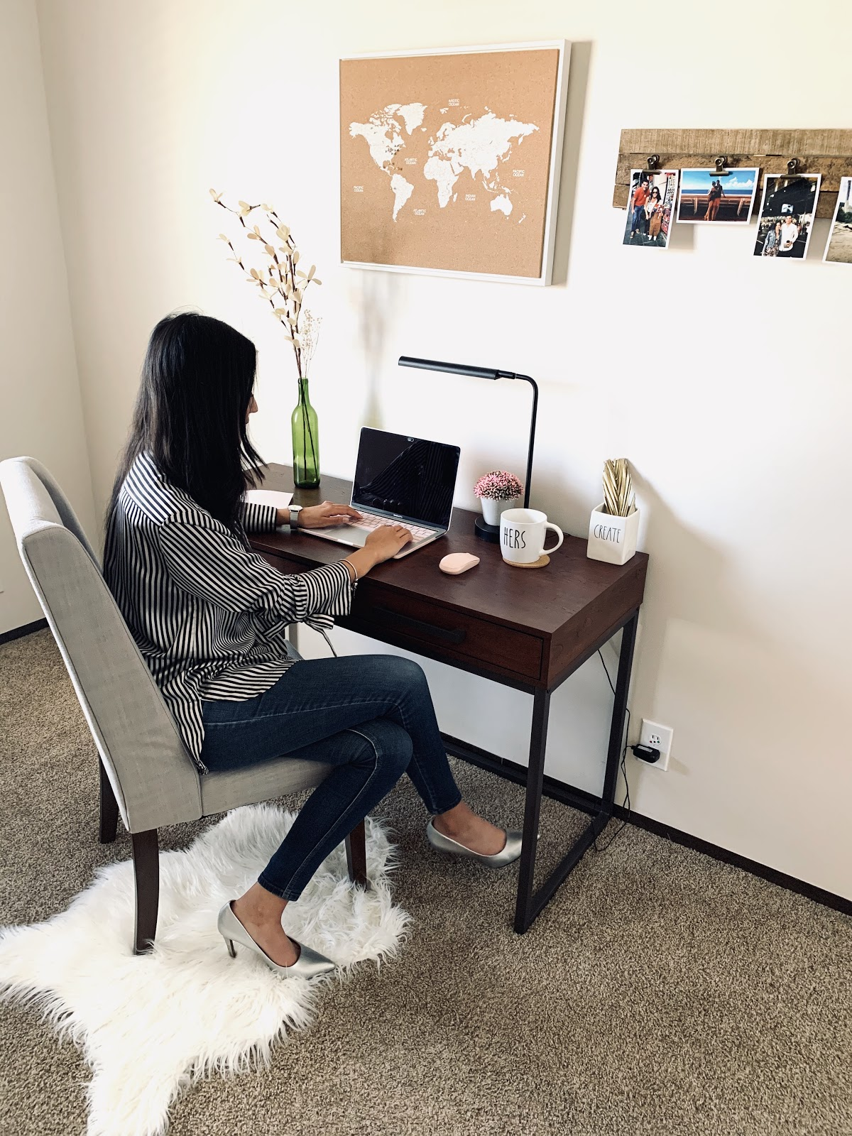 Woman sitting at desk in home office
