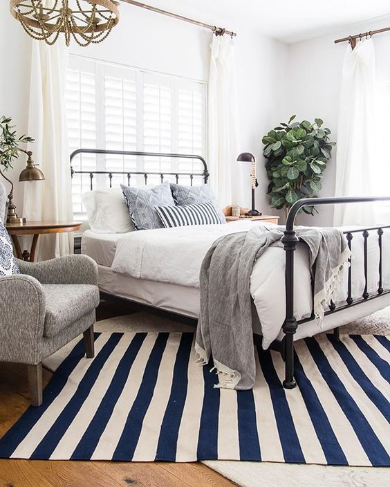 Neutral Bedroom Decorated with a Striking Rug