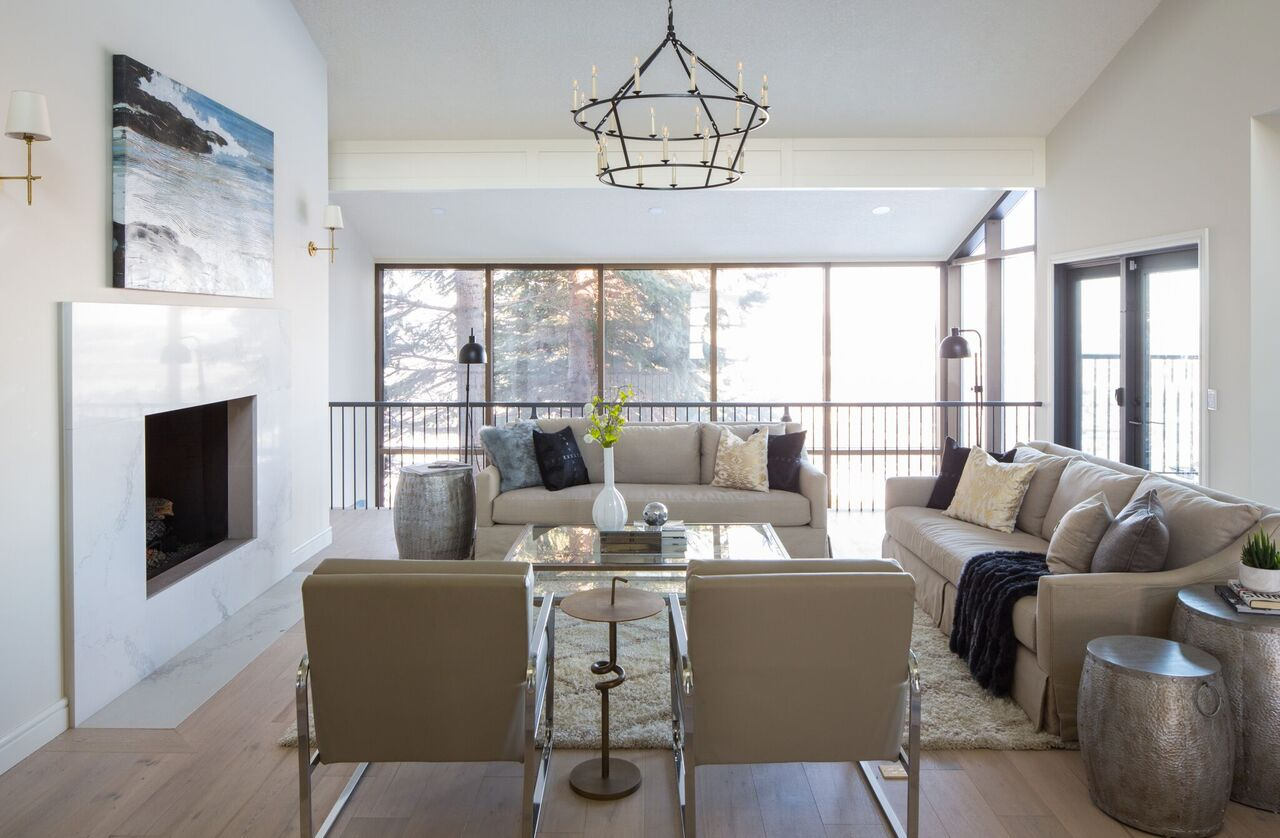NW Calgary modern traditional living room, chandelier lighting, caesarstone quartz fireplace