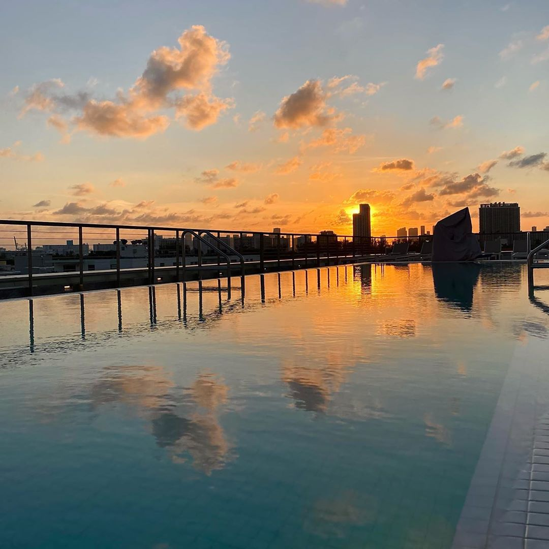 Sunset over the Betsy rooftop pool