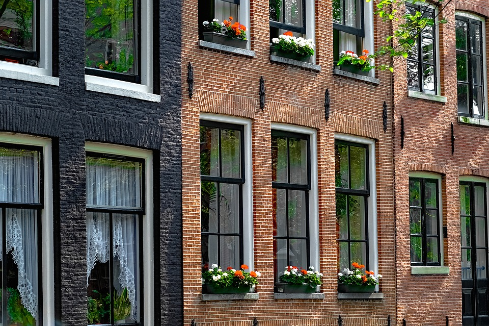 Painted-Brick-Brick-House-Home-Flowers-2666363.jpg