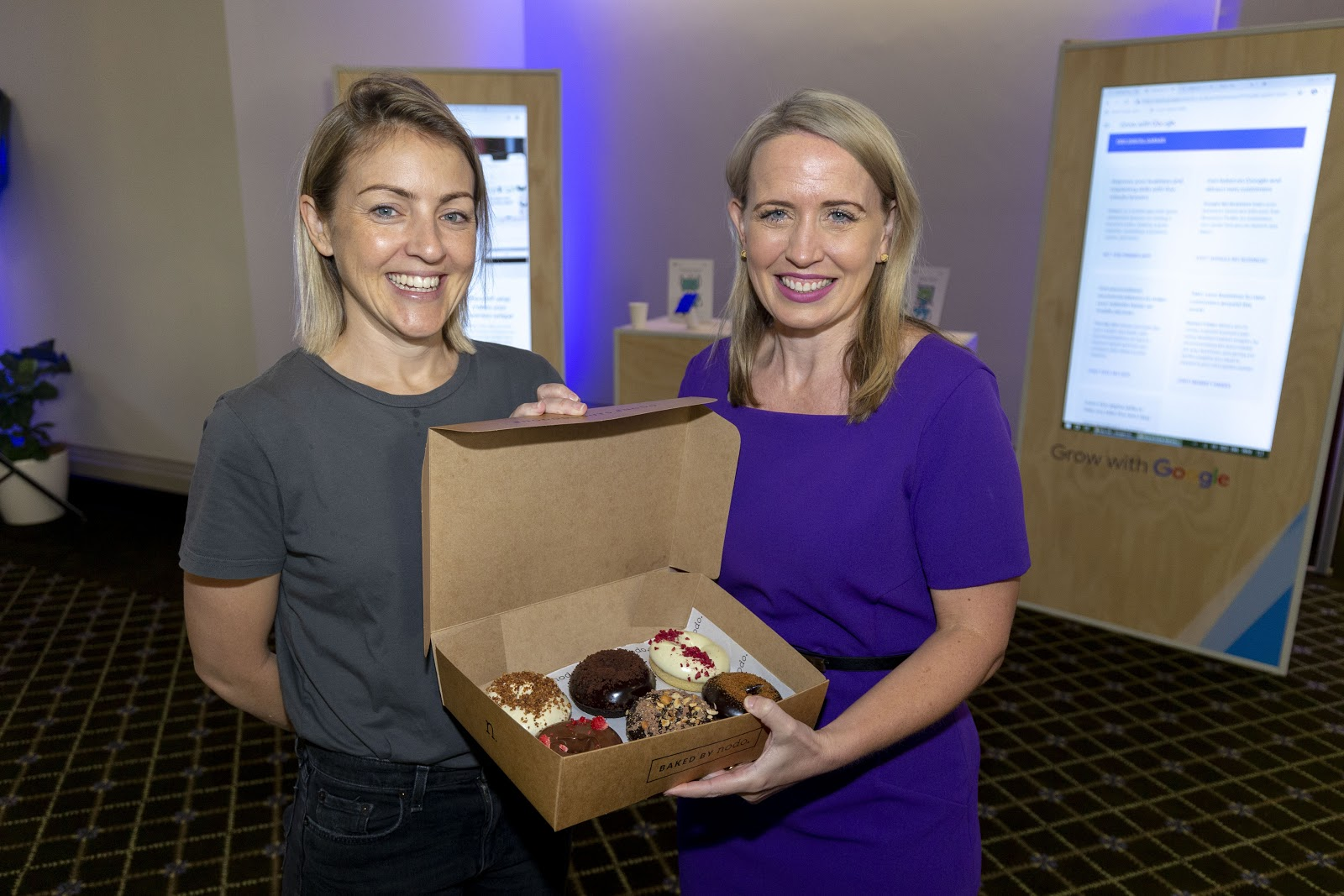Photo of Nodo owner Kate Williams presenting donuts to Minister for Innovation, Kate Jones