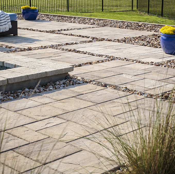 stone patio slabs with small rocks in between