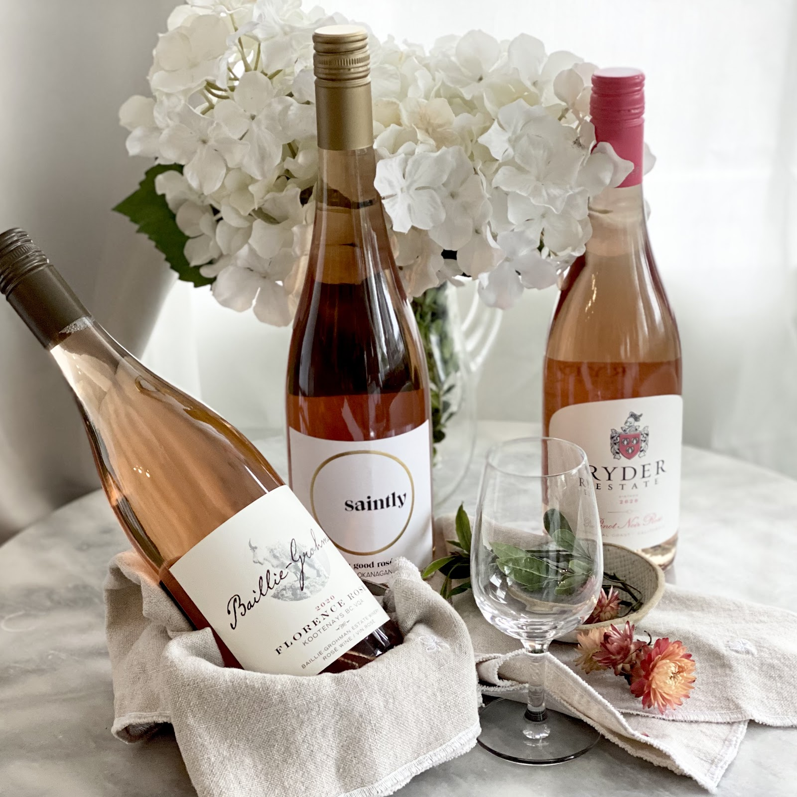 Rose All May Rose wine tasting with Barb Wild of Good Wine Gal and Alison Kent of the Home Kitchen beautiful pink bottles of rose wines