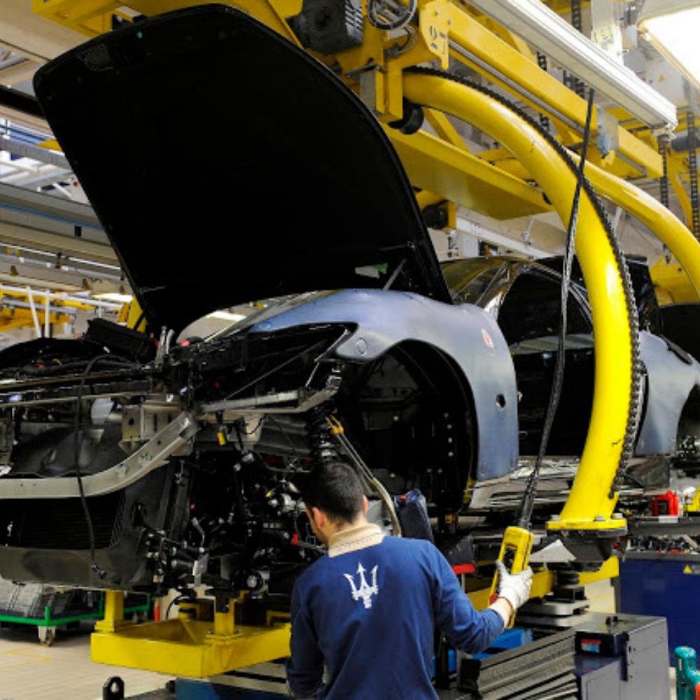 A car mechanic working on the Maserati car prototype