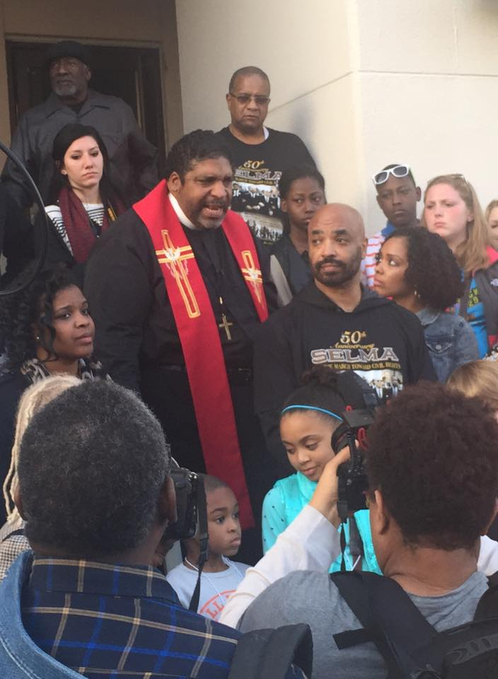 Reverend Barber of the North Carolina NAACP and Moral Monday Movement preaches to a multi-racial crowd on the Dallas County Courthouse steps. He addressed the current crisis of the Voting Rights Act, and pointed to sacred ground beneath his feet where Annie Lee Cooper was beaten for registering to vote.