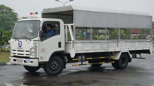 A person driving a truck  Description automatically generated with low confidence