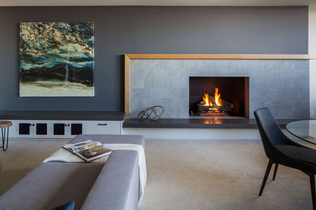 NW Calgary basement family room modern traditional fireplace and sofa