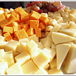 photo showing cubes of several kinds of cheese