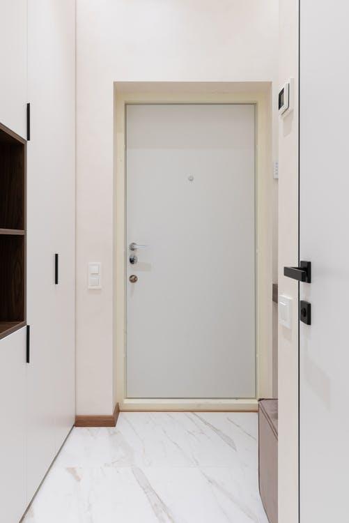 Entryway flooring in front of exterior door