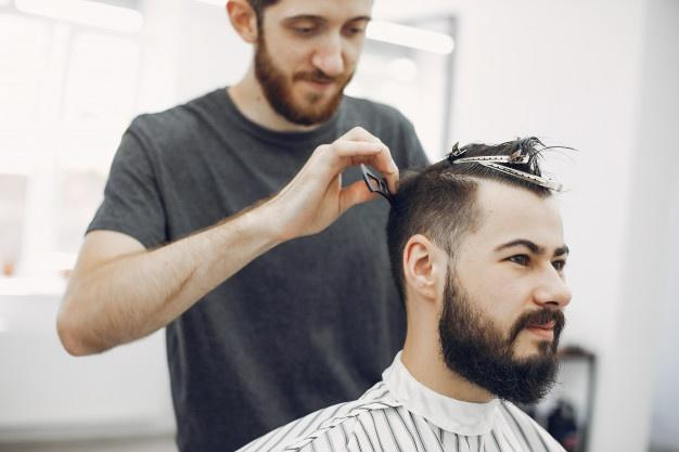 Stylish man sitting in a barbershop messy hairstyle