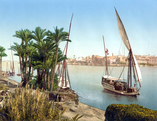 Image of EGYPT: CAIRO A sailboat on the Nile River with the city in the background, Cairo, Egypt. Photograph, late 19th century, © Granger / Bridgeman Images