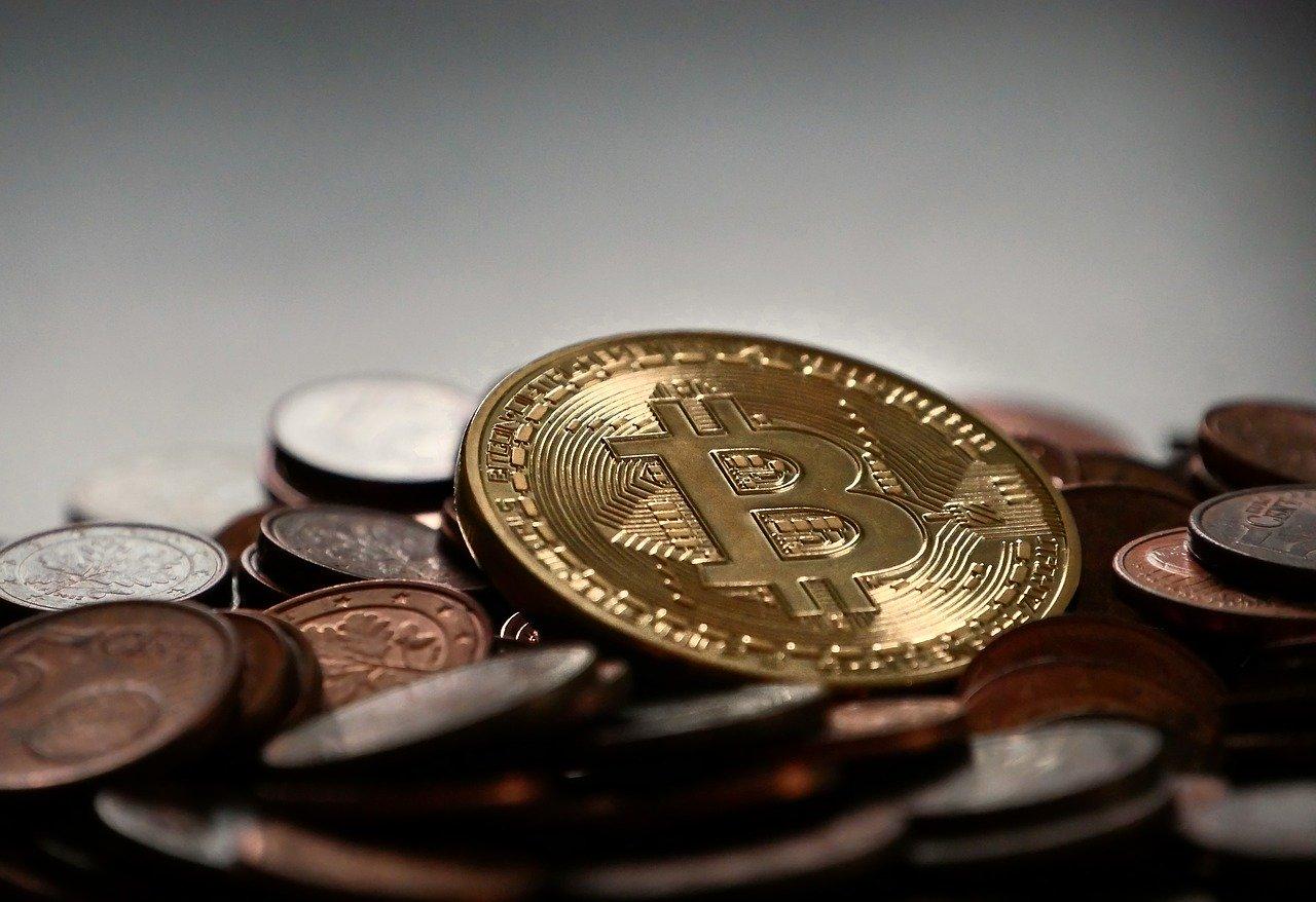 a coin with a Bitcoin logo on it