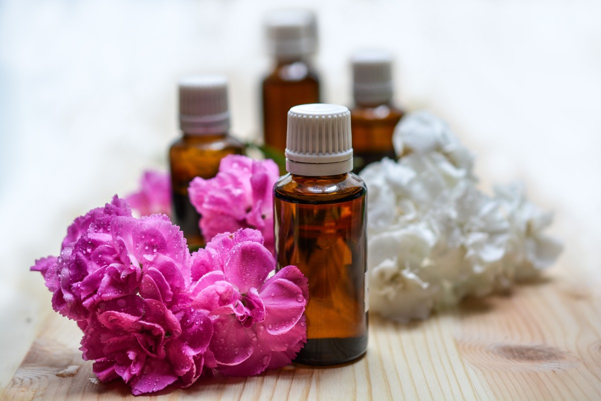 Jasmine Essential Oil: bottle with flowers