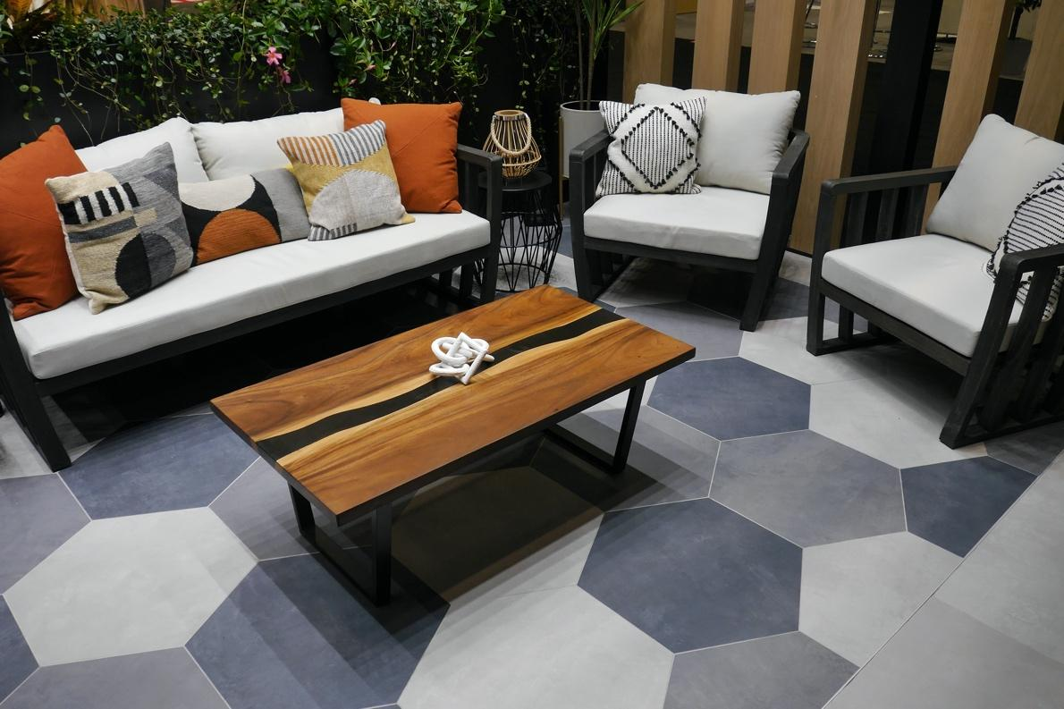 Large hex tile in varying shades of gray on an outdoor patio