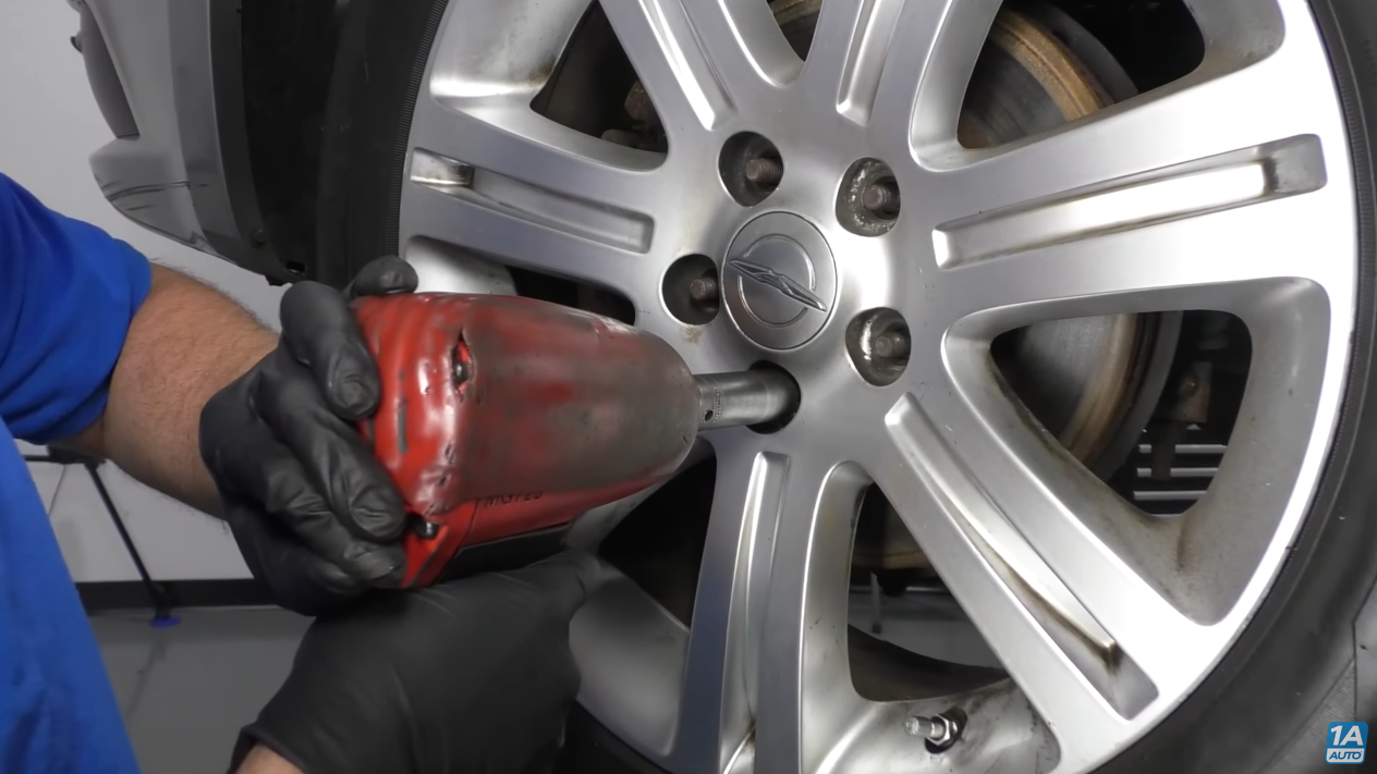 Using a impact wrench to remove a stripped lug nut