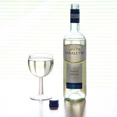 Canaletto pinot grigio wine bottle near glass of wine