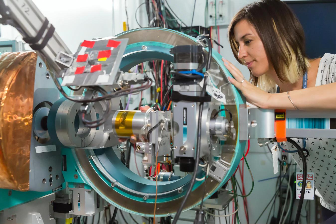 Scientist adjusting instrumentation of device