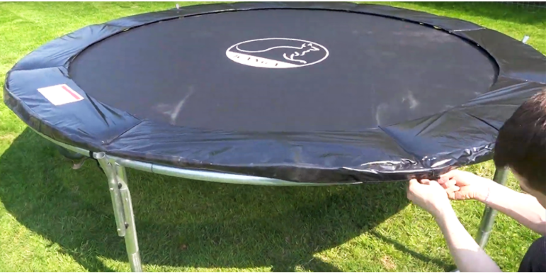 add the trampoline spring cover and padding to the frame,