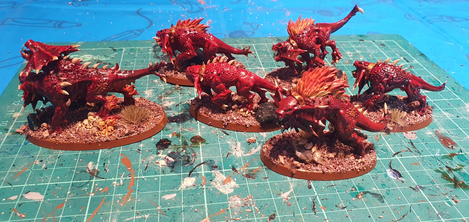 Fleshhounds of Khorne models, painted with red flesh and orange/yellow flame effects.