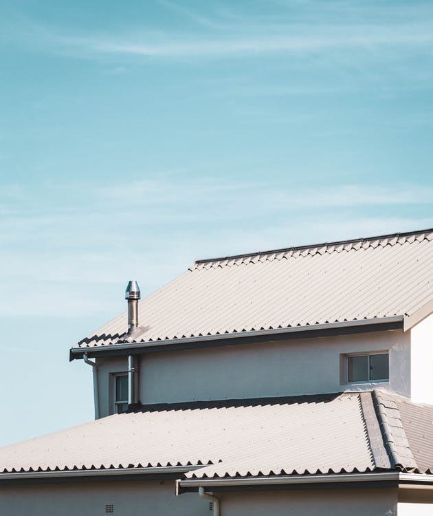 White Roof Of House Under Blue Sky