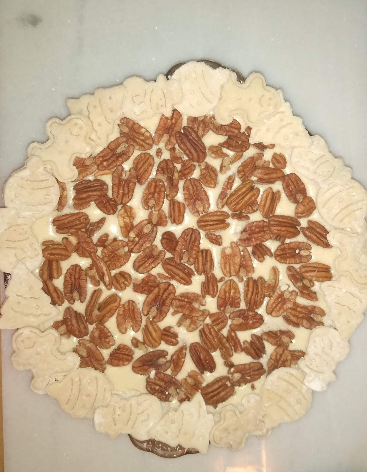 raw pecan pie topped with pie cookies