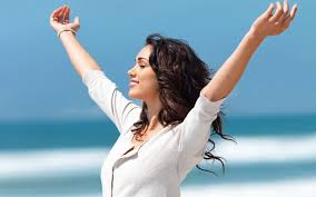 Joyful woman outstretched arms.jpg
