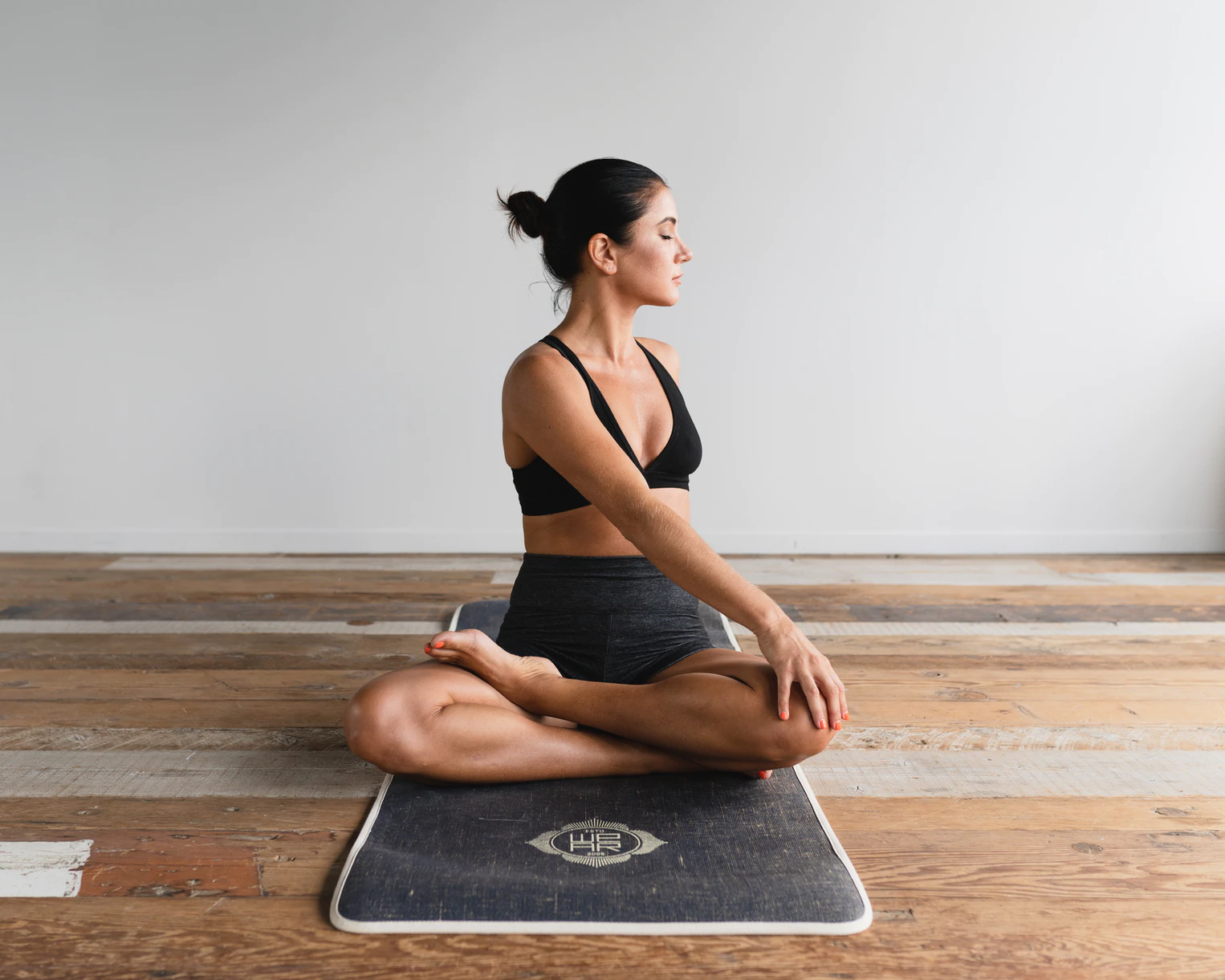 photograph of lady on a yoga mat