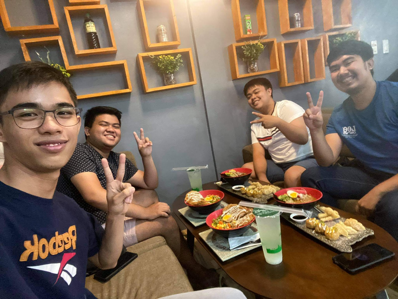 BlackPool Scholars Nagata, Secret, Joel and Xyzev, enjoying a meal together after cashing out their SLP earnings to fiat