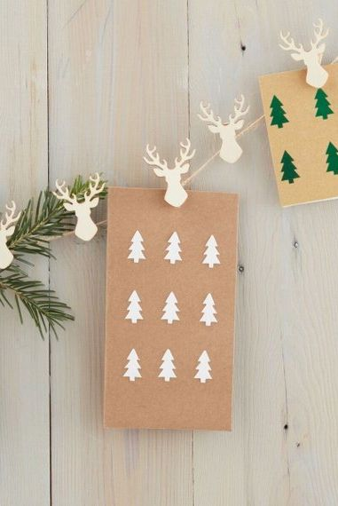 Reindeer Christmas Card Hanger: These 25 DIY Christmas Card Holders - That Double As Festive Decor will allow you to beautifuly display your cards and will also give you some great decor.