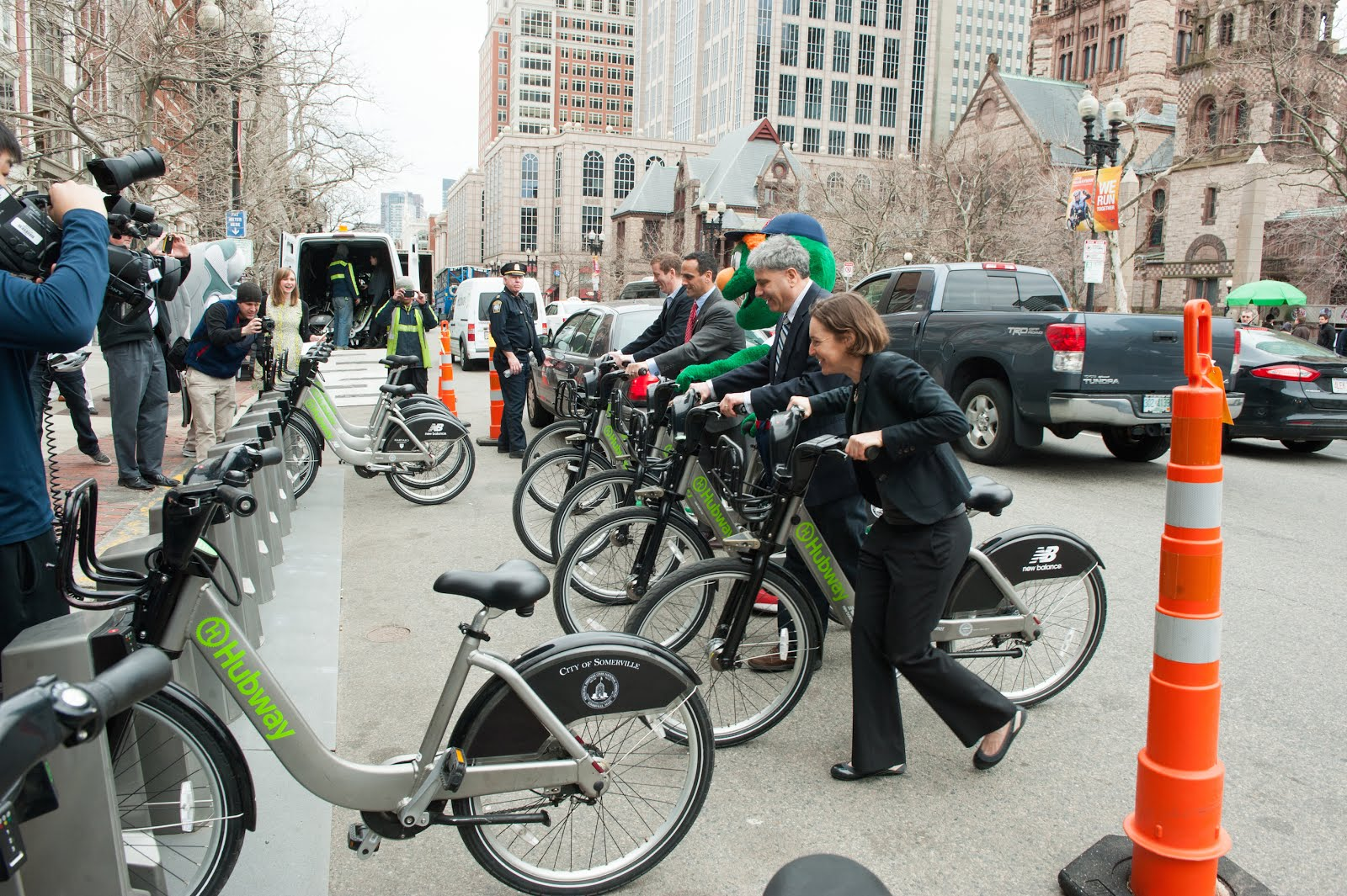 Hubway launch event with dignitaries on bikes.