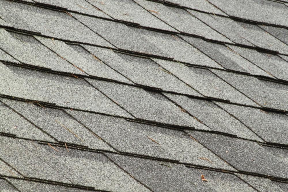 Close up of grey asphalt shingles