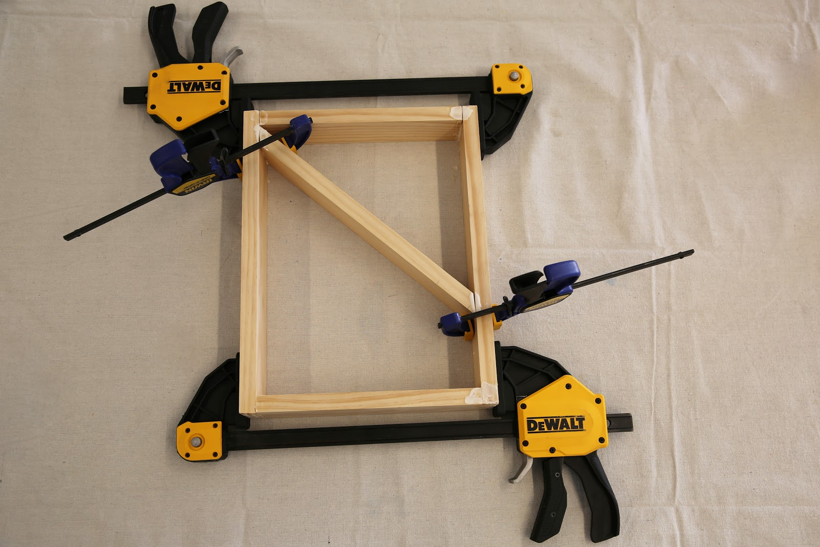 Securing wood pieces with clamps.