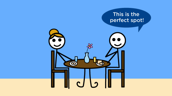 "Two stick figures are seated at a table and eating food. One stick figure says, ""This is the perfect spot!"""