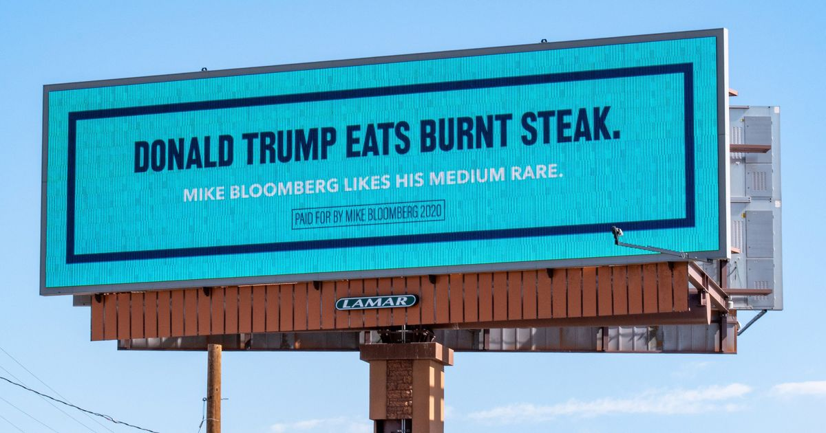 """Billboard by Mike Bloomberg in 2020 with the text """"Donald Trump Eats Burnt Steak. Mike Bloomberg likes his medium rare."""""""