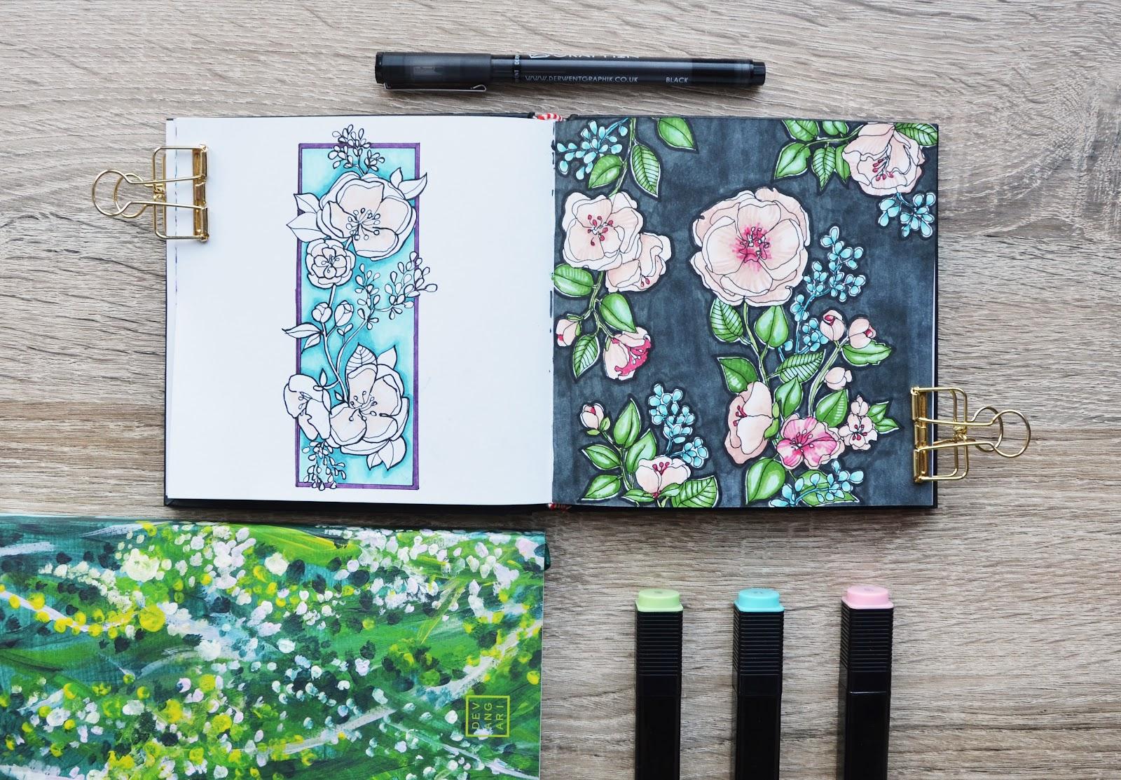 Kwiaty rysowane markerami alkoholowymi, w tle notes w kropki Garden