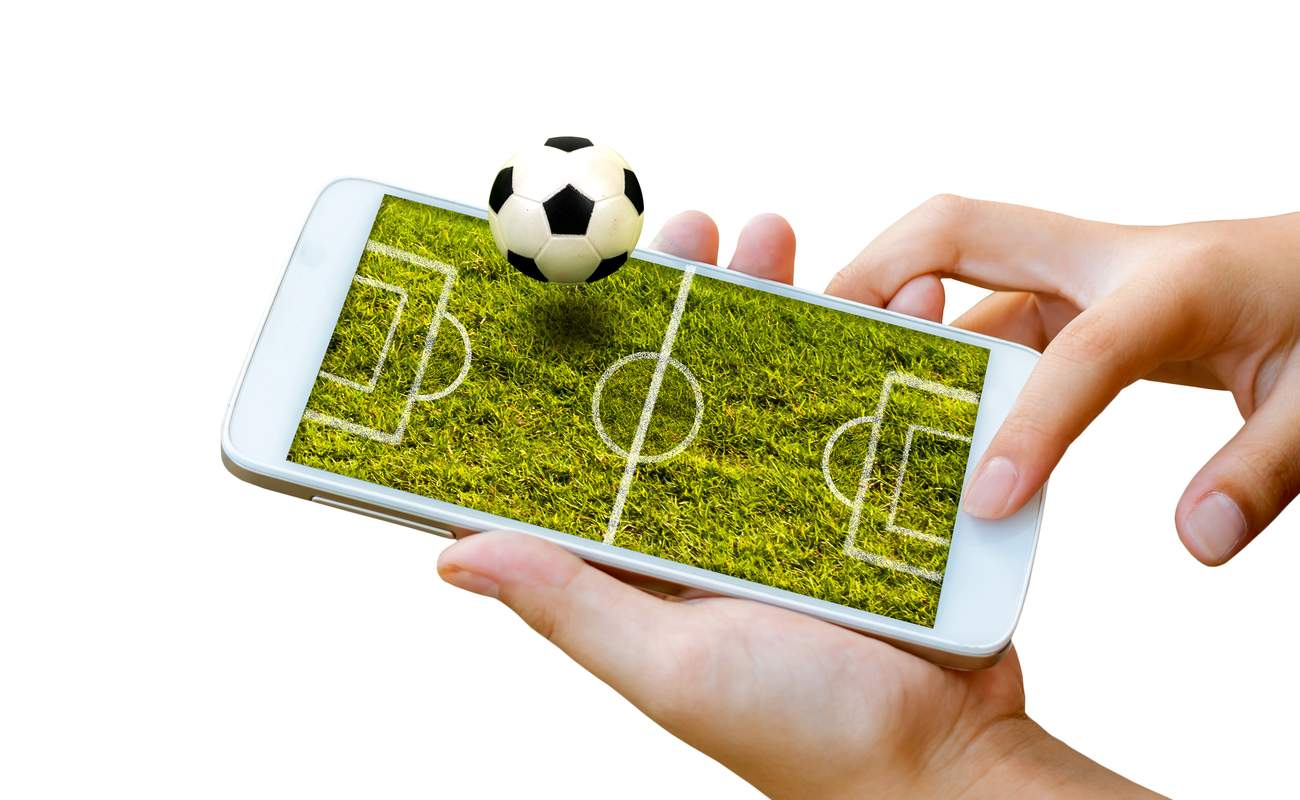 Touch screen smartphone isolated on white with football field on screen as 3d image