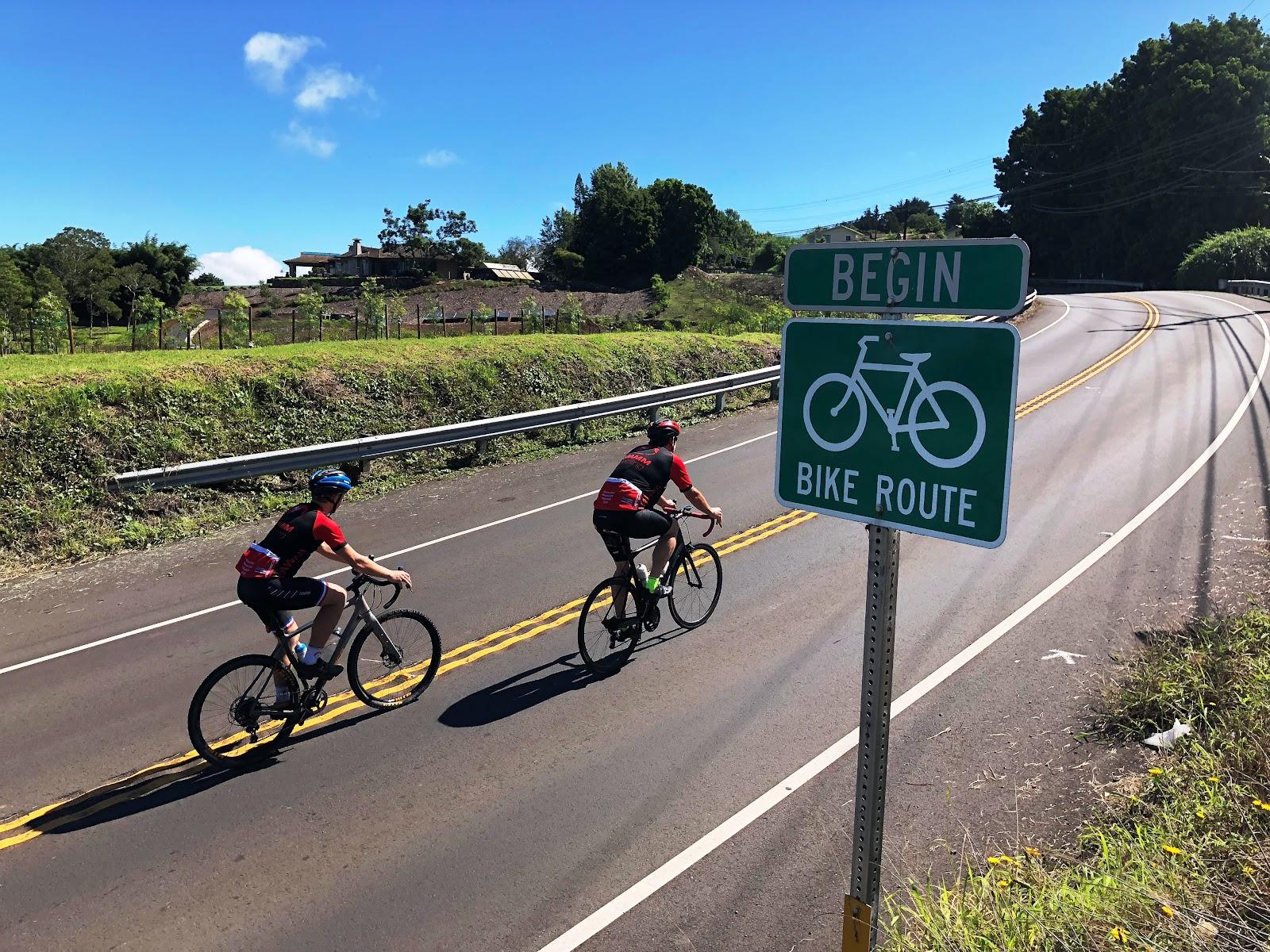 Bicycle climb of Waipoli Road - cyclist and bike sign at start of Waipoli Rd