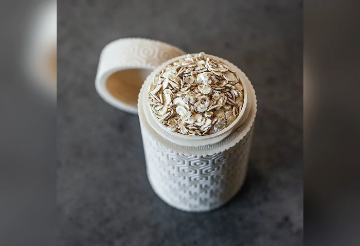 3d printed cylindrical textured box with oats inside