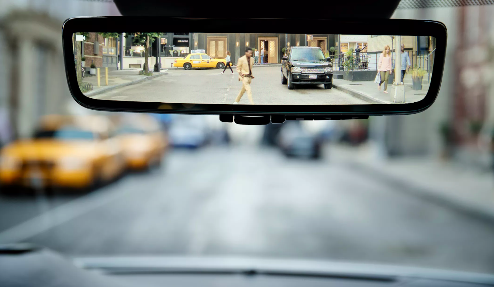 A view of what we see in the rear-view mirror of an automobile.