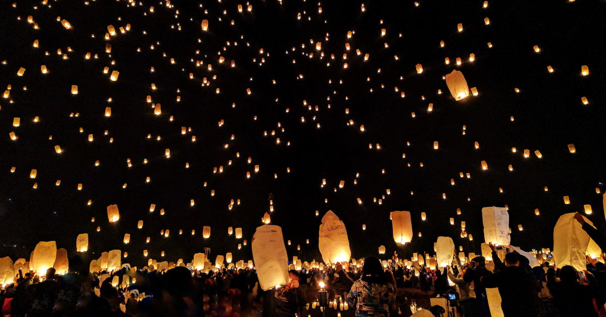 People setting lanterns into the night sky during the Chinese Lantern Festival